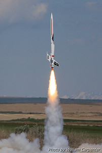 An upscaled Estes Satellite Interceptor lifts off on a Level Two certification attempt.