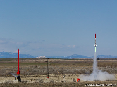 My Madcow Little John is first off the pad in a drag race with a Binder FITS Flyer flown by my father, Luke Carpenter. Both rockets are flying on Mojave Green motors: the Little John on an H250, and the FITS Flyer on an I245.