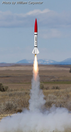"My Madcow Rocketry 4"" Little John on an H180 White Lightning."