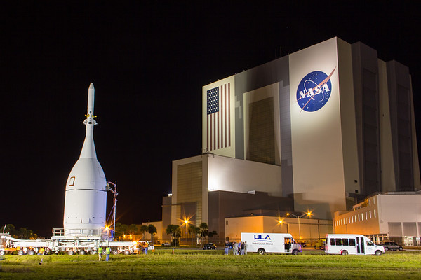 Orion capsule posing in front of the VAB