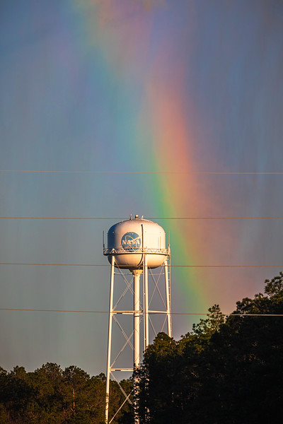 The plume of steam ejected from the flame trench even created a few rainbows behind the NASA water tower.