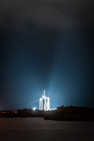 Stormclouds roll into NASA's Kennedy Space Center on the evening of May 29th, 2020 as xenon lights illuminate historic pad 39A.
