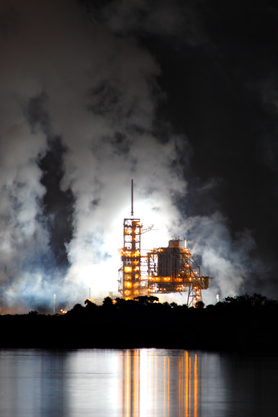 Steam rises from the launch pad. <i>Discovery</i>, meanwhile, is already well over the Atlantic, hundreds of miles downrange.