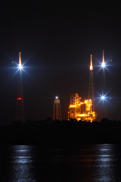 LC39B, the northernmost launch pad, at the time undergoing conversion for use with Ares launch vehicles. The three towers with strobes are lightning masts.<br /> <br /> Today the pad is being dismantled following the cancellation of the Constellation program.