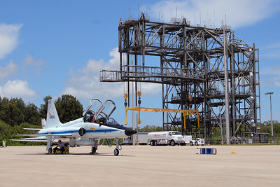 Tuesday, April 26 - One of the shuttle crew's NASA T-38 Talons parked before the towering Mate-Demate Device (MDD) at the Shuttle Landing Facility.