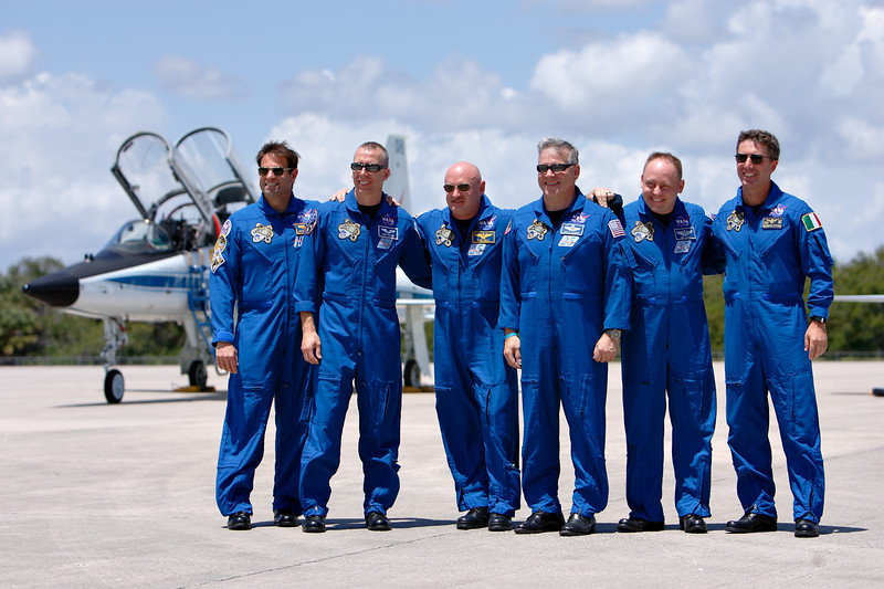 Tuesday, April 26 - Space Shuttle <i>Endeavour's</i> final crew poses for a group photo. The crew, from left to right: Mission Specialist Greg Chamitoff, Mission Specialist Drew Feustel, Commander Mark Kelly (USN), Pilot Greg Johnson (USAF Ret.), Mission Specialist Mike Fincke (USAF), and Mission Specialist Roberto Vittori (IAF).