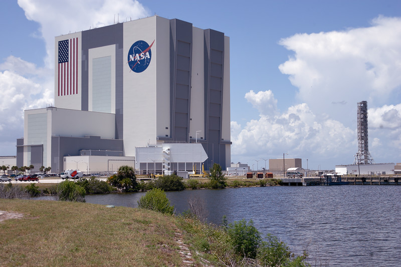 Tuesday, April 26 - The Vehicle Assembly Building (VAB) as seen from the Launch Complex 39 Press Site. The structure on the right is the mobile launch tower constructed for the now-cancelled Constellation program.