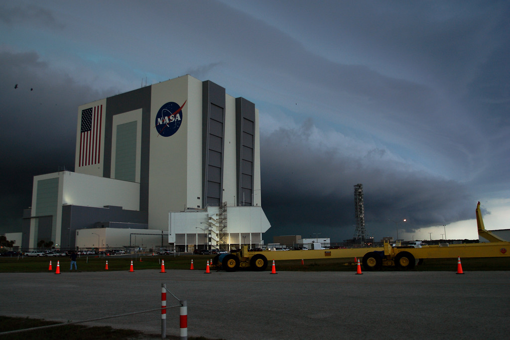 Thursday, April 28 - A severe thunderstorm bears down on Kennedy Space Center ahead of Rotating Service Structure (RSS) retract at the launch pad. The ominous leading edge of the storm is a shelf cloud. Severe weather would ultimately delay RSS retract five hours.<br /> <br /> In this image, a greenish hue can be seen filtering through the storm. This color can be indicative of hail, which was also indicated on radar. The storm prompted a Severe Thunderstorm Warning for the area.