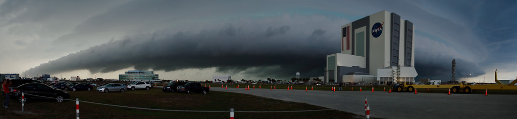 Thursday, April 28 - A severe thunderstorm bears down on Kennedy Space Center ahead of Rotating Service Structure (RSS) retract at the launch pad. The ominous leading edge of the storm is a shelf cloud. Severe weather would ultimately delay RSS retract five hours.<br /> <br /> In this image, a greenish hue can be seen filtering through the storm. This color can be indicative of hail, which was also indicated on radar. The storm prompted a Severe Thunderstorm Warning for the area.<br /> <br /> This image is a panorama consisting of multiple exposures.