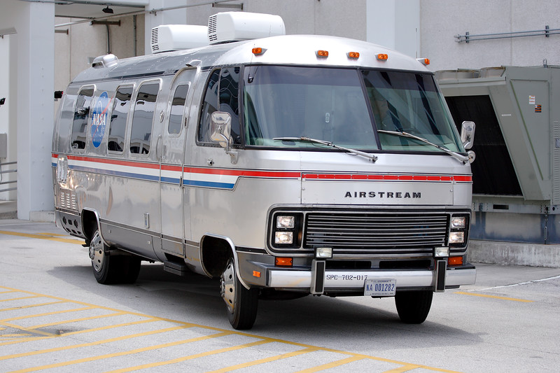 Friday, April 29 - The Astrovan departs for Launch Complex 39. News of the scrub broke while the Astrovan was still en-route, prompting a U-turn and return to headquarters.