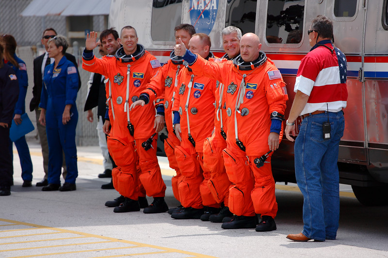 Friday, April 29 - <i>Endeavour's</i> crew walks out to the Astrovan ahead of the first scheduled launch attempt.