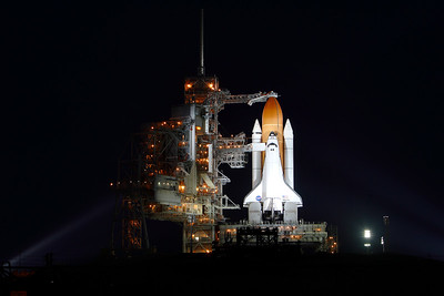 Atlantis seen on the launch pad later in the evening.