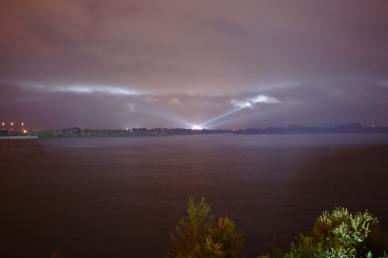 In this view from the Press Site, the launch pad's xenon lights can be seen lighting the clouds.