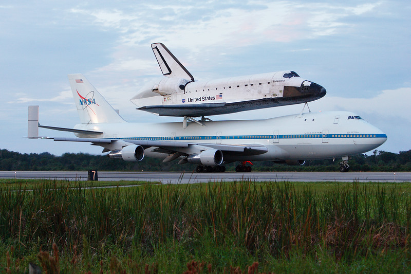 With Endeavour on its back, the 747 Shuttle Carrier Aircraft begins to taxi towards the North end of the runway.