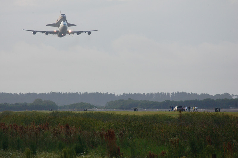 The pair returns to the Shuttle Landing Facility for one final, low pass across the runway.