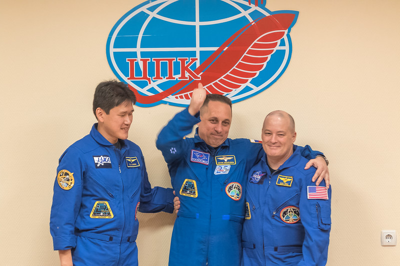Scott Tingle posing for a photo with his crewmates at the conclusion of the Crew Press Conference at the Cosmonaut Hotel in Baikonur, Kazakhstan on December 16th, 2017. (Photo Credit: Trevor Mahlmann)