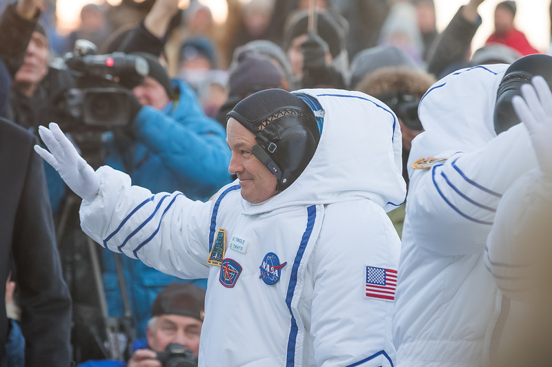 NASA Flight engineer Scott Tingle waving to friends, family, and members of the media at the Baikonur Cosmodrome in Kazakhstan on December 17th, 2017. (Photo Credit: Trevor Mahlmann)