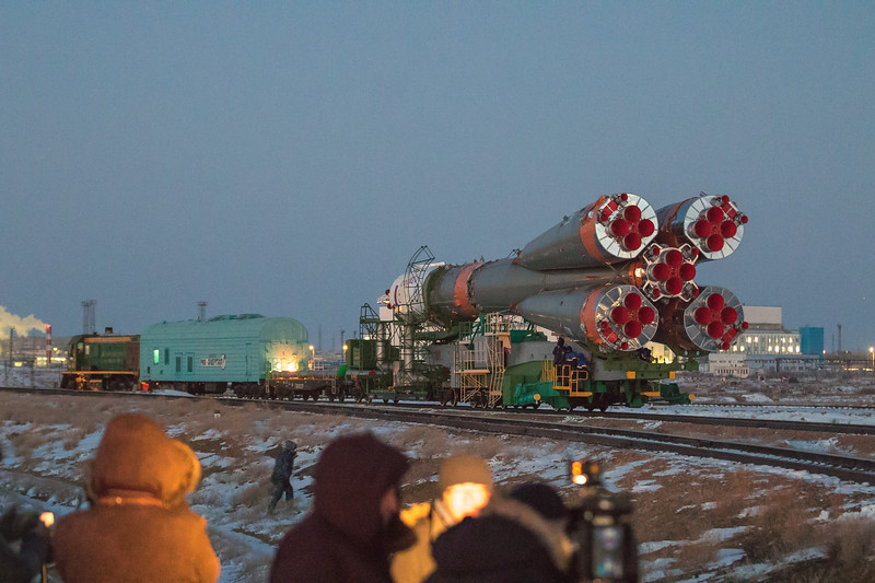 Members of the media watch as the Soyuz rocket is rolled out to the launch pad at sunrise in Baikonur, Kazakhstan on December 15th, 2017. (Photo Credit: Trevor Mahlmann)