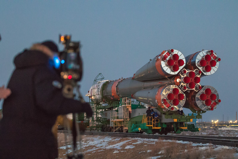 A member of the media watches the Soyuz rocket being rolled out to the launch pad at sunrise in Baikonur, Kazakhstan on December 15th, 2017. (Photo Credit: Trevor Mahlmann)