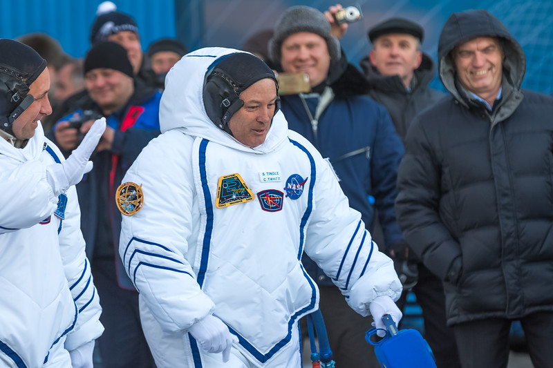 NASA Flight engineer Scott Tingle walking out of Building 254 at the Baikonur Cosmodrome after donning their Sokol spacesuits in Kazakhstan on December 17th, 2017. (Photo Credit: Trevor Mahlmann)