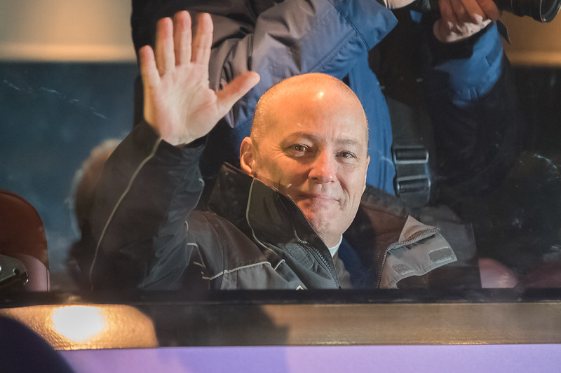 NASA flight engineer Scott Tingle waving to his friends and family after boarding the bus at the Cosmonaut Hotel in Baikonur, Kazakhstan on December 17th, 2017. (Photo Credit: Trevor Mahlmann)