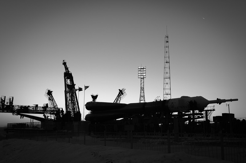 The Soyuz MS-07 rocket rolling up to its launch mount (Gagarin's Start) at sunrise in Baikonur, Kazakhstan on December 15th, 2017. (B/W Photo: Trevor Mahlmann)