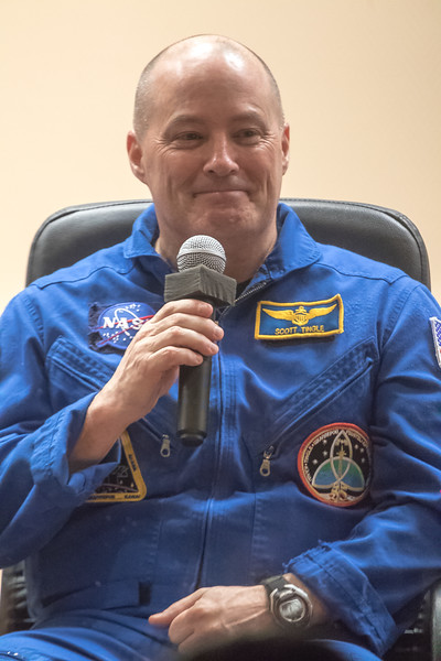 Scott Tingle answering questions from the media during the Crew Press Conference at the Cosmonaut Hotel in Baikonur, Kazakhstan on December 16th, 2017. (Photo Credit: Trevor Mahlmann)