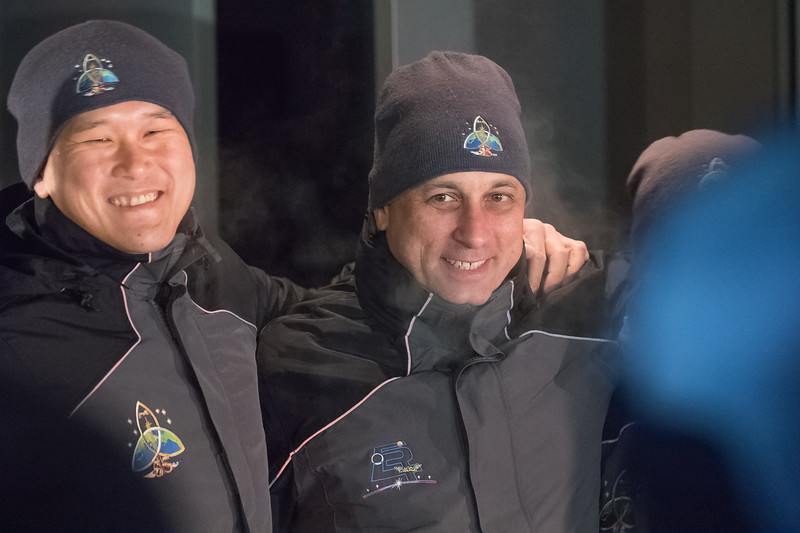 Norishige Kanai (right) and Anton Shkaplerov (right) posing for a photo after exiting the Cosmonaut Hotel in Baikonur, Kazakhstan on December 17th, 2017. (Photo Credit: Trevor Mahlmann)