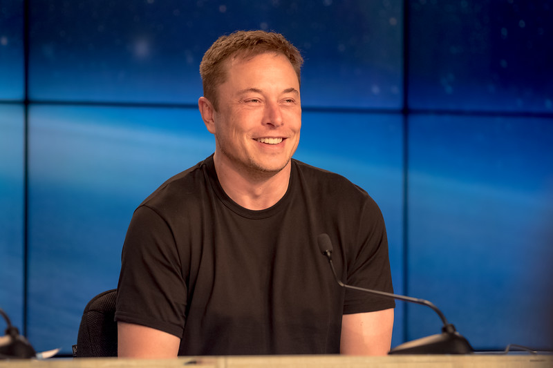SpaceX's CEO and Lead Designer, Elon Musk, smiling at the Falcon Heavy press conference held post-launch.