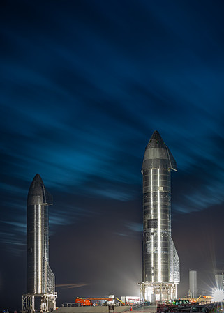 Long exposure photograph of Starship SN9 (left) and SN10 (right) as SpaceX and the FAA work together to get the SN9 flight approved.