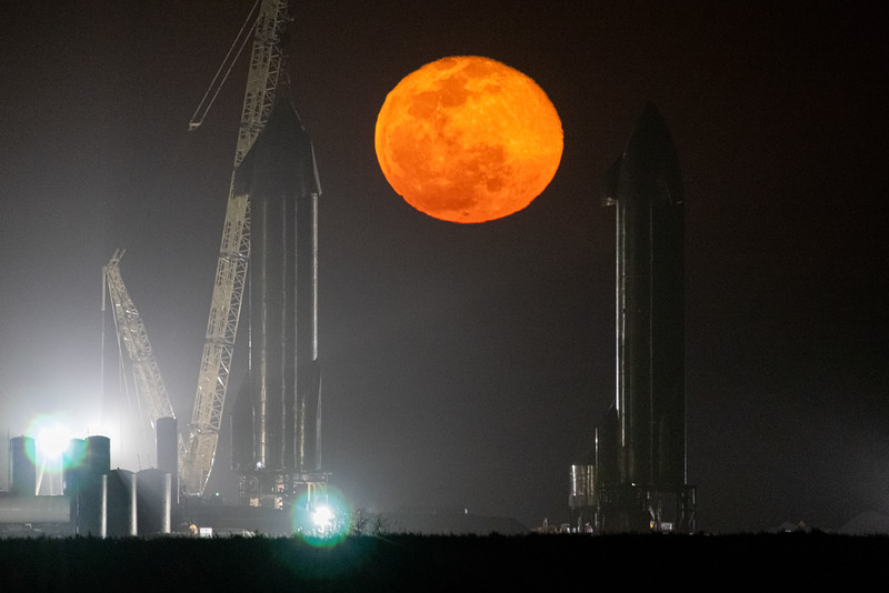 Moonrise between SpaceX's Starship prototypes in Boca Chica Texas. (left - SN9, right - SN10)