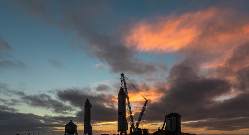 Starship SN10 being lifted onto Pad A in Boca Chica at sunset.