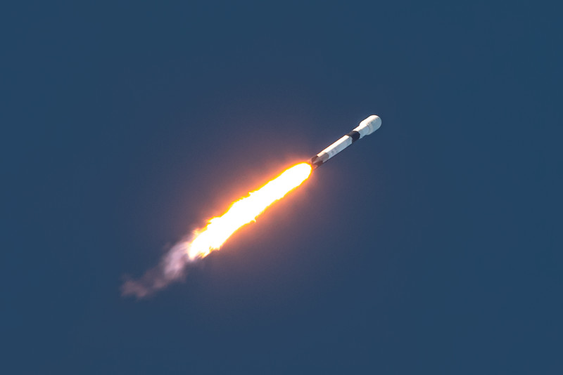 Falcon 9 pitches downrange, heading east from Cape Canaveral on the ANASIS-II mission.