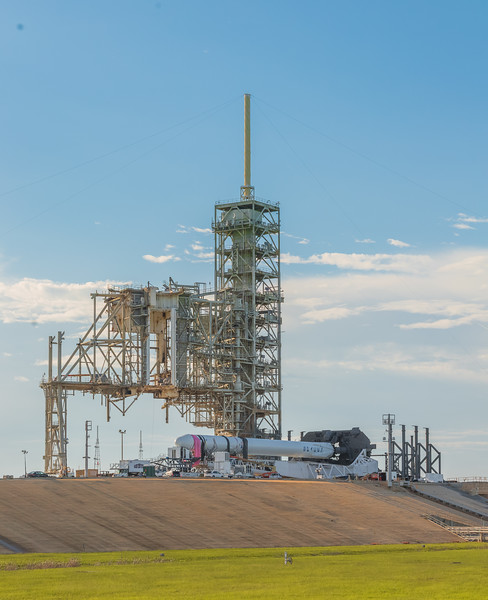SpaceX's Falcon 9 lays horizontal on historic Launch Complex 39A at NASA's Kennedy Space Center as late-load cargo is put in the Dragon spacecraft.