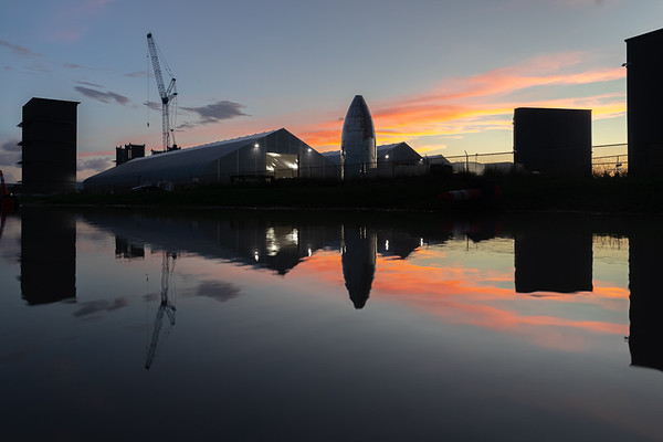 Sunsets, highbays, and the original Starship reveal event nose cone.