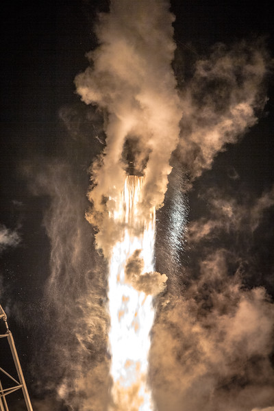 Falcon 9 lifting off from SLC-40, wreathed in condensation from super-chilled liquid oxygen in its fuel tanks.