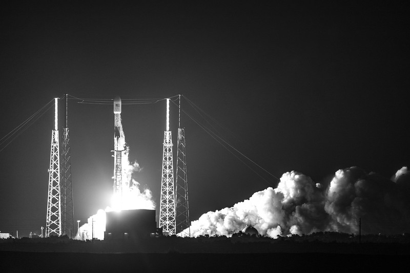 Moody black/white view of liftoff from the ITL Causeway on Cape Canaveral Air Force Station.