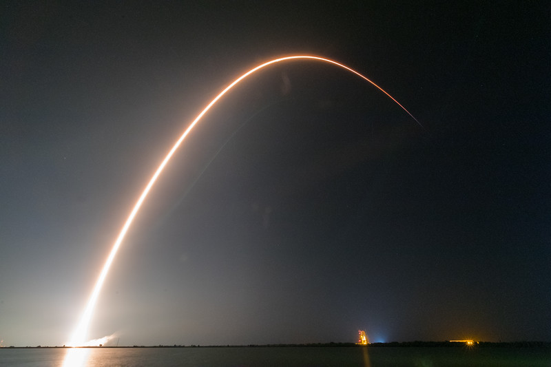 Longer exposure photograph of the Falcon 9 ascending into orbit.