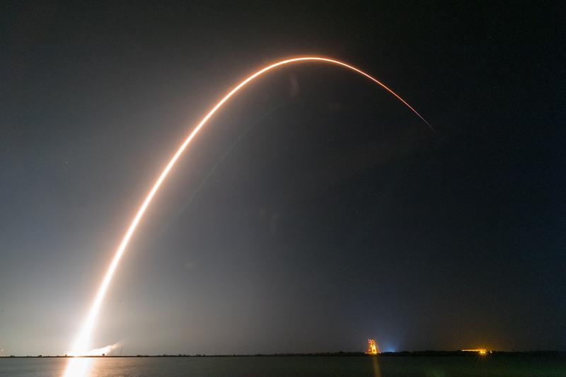 Longer exposure photograph of the Falcon 9 ascending into orbit.
