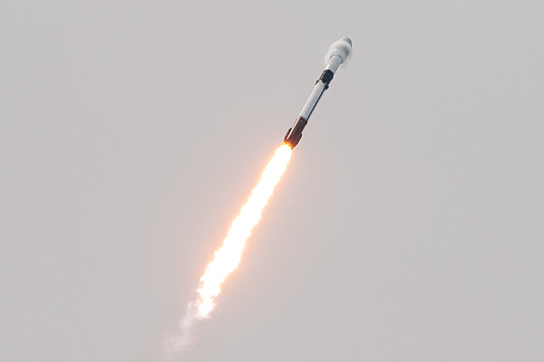 Falcon 9 breaking through the speed of sound as it climbs toward space, targeting a sun-synchronous polar orbit with 88 spacecraft aboard.