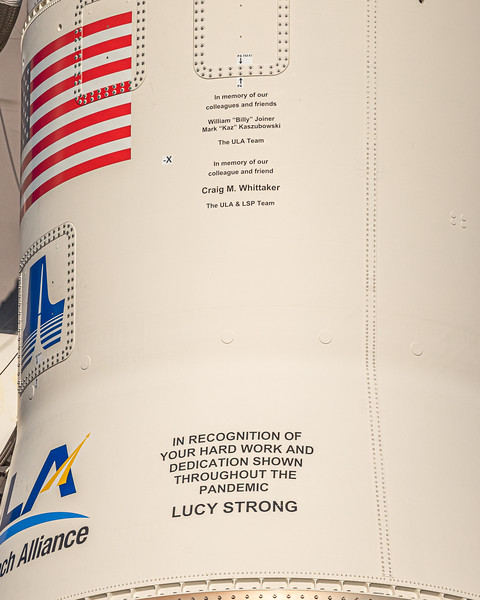 Close-up of the dedications inscribed on the upper portion of the first stage of the Atlas V.