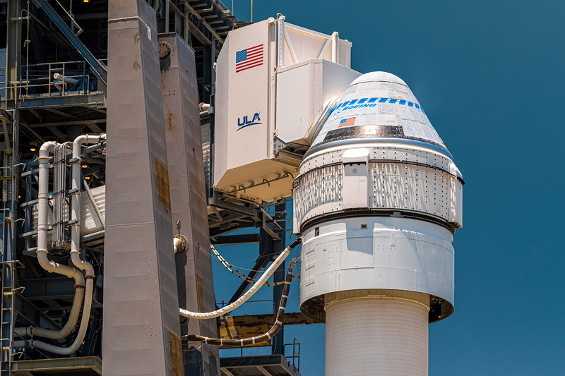Close-up of the Boeing CST-100 Starliner capsule, white room attached, atop the mighty Atlas V launch vehicle at Cape Canaveral's SLC-41.