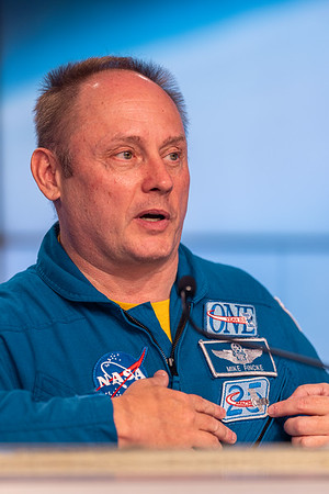 Mike displaying his Mach 25 patch on his flight suit, featuring a Russian Soyuz.