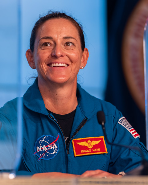 NASA Astronaut Nicole Mann rounds out the complement of three to fly to the Space Station on CFT, grinning ear to ear during the OFT-2 presser.