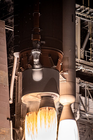 Close-up engine shot of the RD-180 and single AJ60 solid rocket booster.