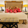 """The Zouzas girls wearing their pink """"Bed Head"""" jammies in their suite at the Lotte New York Palace Hotel"""