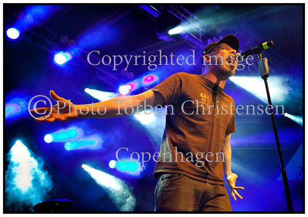 Fredagsrock på Plænen i Tivoli.  Magtens Korridorer på scenen fredag 25. maj 2012. Anders Ramhede, trommer,<br /> Johan Olsen, sang, Niklas Schneidermann, guitar, kor, <br /> Rasmus Kern, guitar, tangenter, kor og Terkel Møhl (bas)    <br /> ------<br /> Friday Rock in Tivoli. Magtens Korridorer on stage Friday, May 25, 2012. Donald Ramhede, drums, Johan Olsen, vocals, Niklas Schneidermann, guitar, choir, Rasmus Kern, guitar, keyboard, choir and Terkel Møhl, Terkel Moehl bass  Photo: © Torben Christensen © Copenhagen