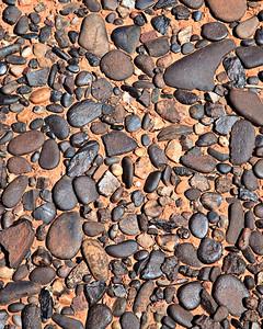 Desert pavement of San Juan River gravels several hundred feet above the current river level