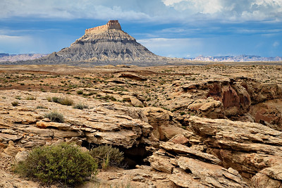 Factory Butte with Ferron Sandstone exposed in the foreground