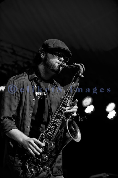 Hamilton Loomis and his band from Texas headline Friday night's stage at the 2011 Mt. Baker Rhythm and Blues Festival. Energetic and youthful, he did leaps and jumps even flying into the audience from a 4 foot plus tall stage. Stratton Doyle, saxophone